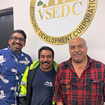 Juan Reyna (right) and Luis Gutierrez (center) at the South LA BusinessSource Center after successfully applying for permits required by the City of Los Angeles Sidewalk and Park Vending program
