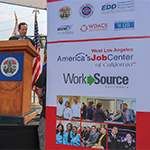 Grand opening of the West LA WorkSource center, location signage on the ceremony stage