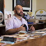 Indie Printing owner Andy Rosillo at the front counter of his South LA business